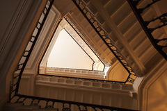 Triangle shaped flight of stairs, looking up. Abstract interior fragment, triangle shaped flight of stairs, looking up Stock Photos
