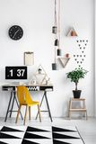 Triangle shaped shelves. Triangle shaped wooden shelves hanging on white wall in industrial flat of handyman Stock Photography