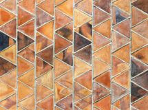 A triangle slab of baked clay, used in overlapping rows for cove. Ring the wall. banked clay wall texture for background royalty free stock image