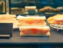Triangle slice sandwich egg and crab stick salad with flying fish roe, sandwiches Japanese style. With blur background royalty free stock photo