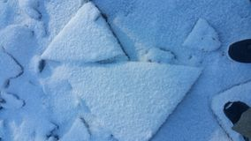 Triangle smile. Snowy ice Natural Symmetry Royalty Free Stock Photos
