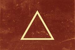 Triangle sur le fond foncé Photos libres de droits