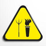 Triangle with a symbol `torch and pitchforks`. Vector illustration. Black and white picture in a yellow triangle on a light background. Vector illustration Royalty Free Stock Photography