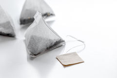 Triangle teabags on white background mockup royalty free stock photos