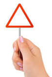 Triangle Traffic Sign In Hand Stock Photos