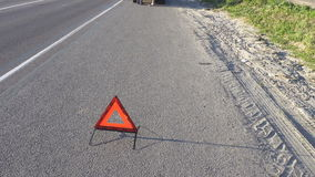 Triangle the warning triangle standing on the road stock video footage