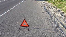 Triangle the warning triangle standing on the road stock footage