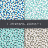 Triangle winter holidays patterns set. Blue, grey, brown vector seamless triangular backgrounds. Triangle winter holidays patterns set. Vector seamless Royalty Free Stock Photo