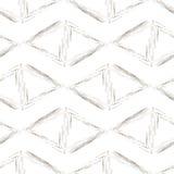 Triangles beiges sur un fond blanc Images libres de droits