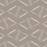 Triangles blanches sur un fond beige Images stock