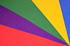 Colored triangles made of paper. Triangles made of colored paper. The colors are basic bright. Stripes alternate royalty free stock photos