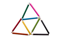 Triangles of pencil colors on a white backgroiund. Pencil colors on a white backgroiund stock images