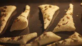 Triangles of puff pastry inside oven. Baking tray inflate Baked and rouge time Lapse stock footage