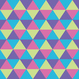 Triangles seamless geometric pattern. Seamless geometric pattern of triangles in pink, green, blue and violet Royalty Free Stock Photo