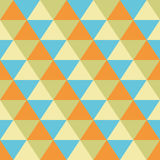 Triangles seamless geometric pattern. Seamless geometric pattern of triangles in yellow, orange, green and blue Royalty Free Stock Photo
