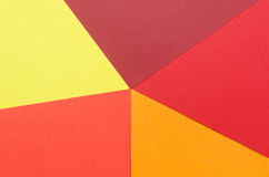 Triangles of warm-colored construction paper Royalty Free Stock Photo