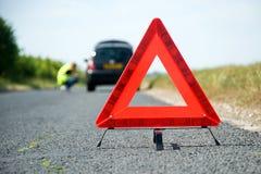 Triangolo d'avvertimento rosso Fotografia Stock Libera da Diritti