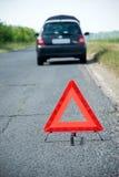 Triangolo d'avvertimento rosso Fotografia Stock