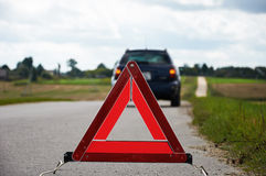 Triangolo d'avvertimento rosso Fotografie Stock Libere da Diritti