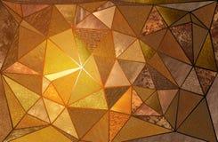 Triangulära guldtexturer Arkivbild