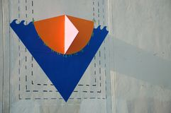 Triangle building art in Portland, Oregon`s Pearl District. Triangular art on a building`s gray wall in Portland, Oregon`s Pearl District royalty free stock images