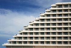 Triangular Building. Facade of a triangular hotel building against blue sky Royalty Free Stock Photo