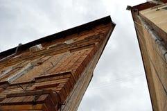 Triangular building. Corner of the old triangular brick dwelling house Stock Photography