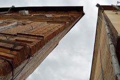 Triangular building. Corner of the old triangular brick dwelling house Stock Photo