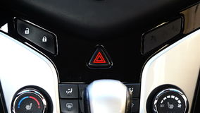 The triangular button of the alarm signal of a motor vehicle in the car. stock footage