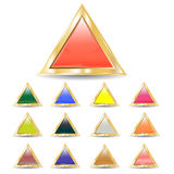 Triangular buttons. Several brilliant varicolored triangular buttons on gold base several brilliant varicolored triangular buttons on gold base Royalty Free Stock Image