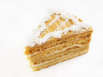 Triangular cake with cream ornament Stock Photography