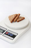 Triangular cakes with cherries on a kitchen scale Stock Photo
