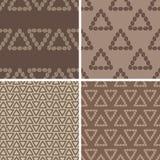 Triangular coffee seamless patterns set. Set of four seamless triangular coffee bean shapes patterns stock illustration