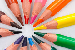 Triangular color pencils circle stock images