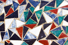 Triangular colorful mosaic texture on wall Stock Images