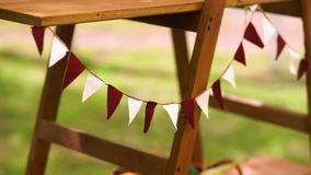 Triangular flags sway in the wind. Holiday decoration stock video footage