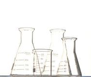 Triangular flask and  beaker Stock Images