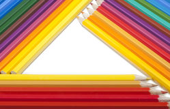 Triangular frame made of colored pencils Royalty Free Stock Images