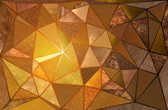 Triangular Gold Textures. Abstract shattered triangle mosaic of various gathered gold textures Stock Photography