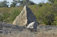 Pyromidal stone. The joke of nature in geometry royalty free stock photo