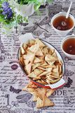 Triangular home made cracker with black and white sesame Royalty Free Stock Images