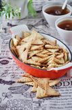 Triangular home made cracker with black and white sesame royalty free stock photo