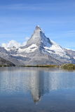 Triangular mountain and reflection Stock Photography