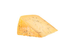 Triangular piece of cheese with herbs isolated on a white backgr Royalty Free Stock Photo