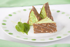 Triangular pieces of cake with chocolate on a Stock Photos