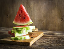 Triangular pieces of a water melon on a kitchen board Royalty Free Stock Photography