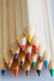 Triangular pile colored wooden pencils. Triangular pile of colored wooden pencils Royalty Free Stock Image