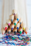 Triangular pile colored wooden pencils. Triangular pile of colored wooden pencils Royalty Free Stock Photography