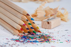 Triangular pile colored wooden pencils Royalty Free Stock Image