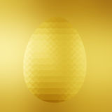 Triangular Polygonal gold Easter egg on golden background Royalty Free Stock Photo
